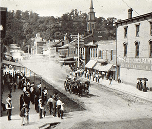 People watching as the Thomas Gaff fire engine passes by, early 1900's.