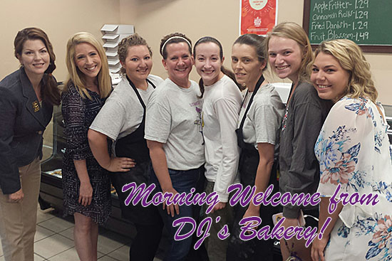 Morning welcome from DJ's Bakery staff, with City Manager Guinevere Emery.
