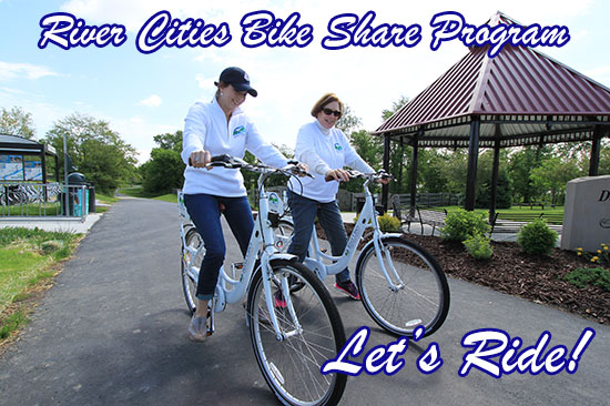 City Manager, Guinevere Emery and a fellow patron enjoying a Bike Share bike ride on the